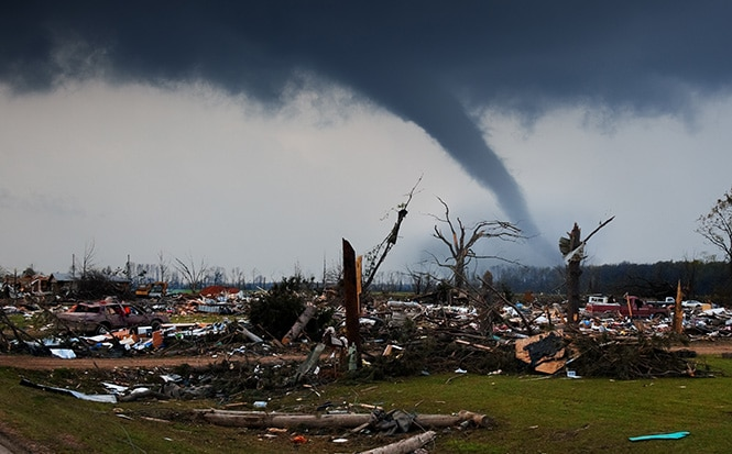 destroyed homes with tornado in background