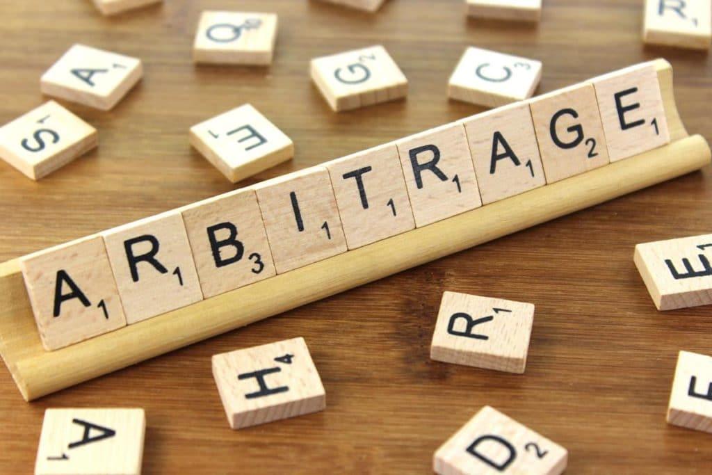 arbitrage spelled on scrabble deck