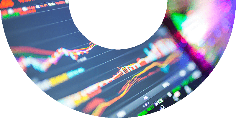 stock charts on computer screen with motion blur