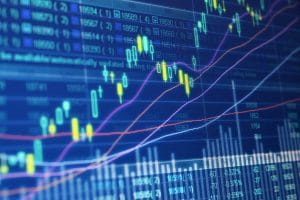 yellow and blue candlestick trading chart tight crop computer screen