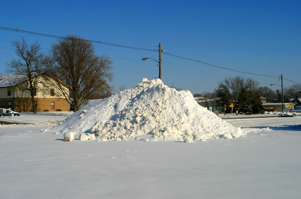 dirty snow mound in parking lot