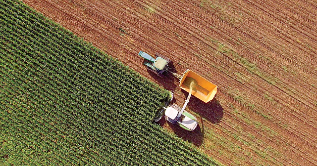 tractor harvesting aerial