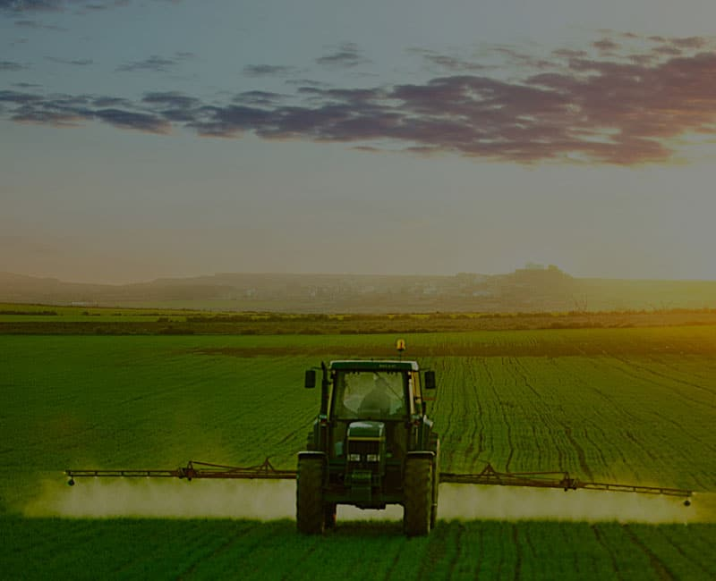 tractor spraying at dawn resource half