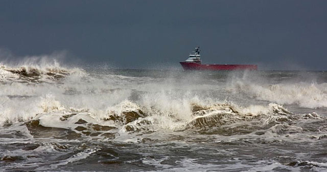 red tanker in rough seas