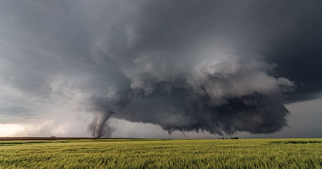 tornado on horizon over plains