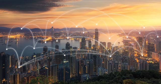 white data point arcs over cityscape sunset