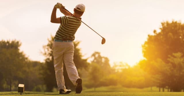 golfer backswing at sunrise