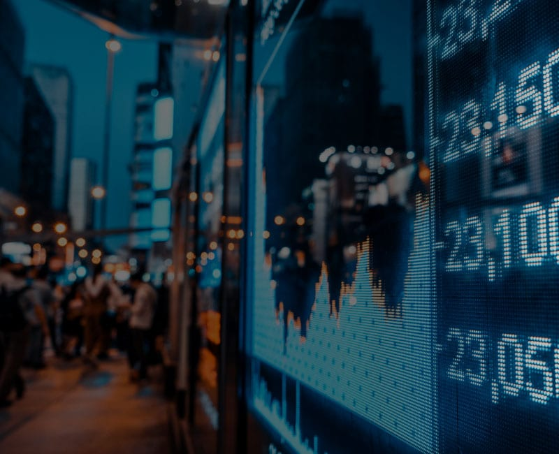 stock ticker and charts along sidewalk
