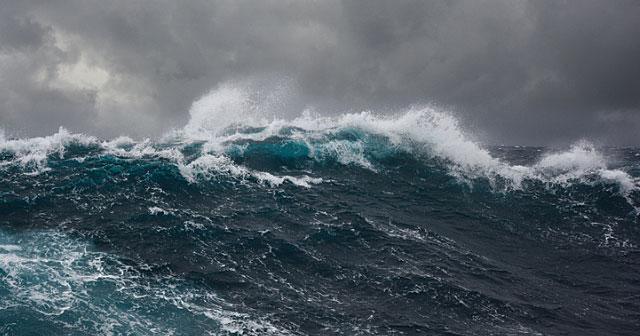 deep blue sea waves with stormy skies