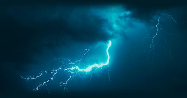 vivid blue lightning in dark sky