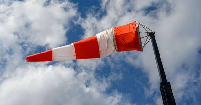 news insights wind sock blue sky clouds