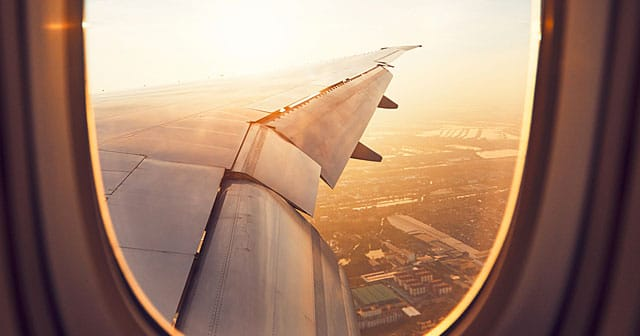 news insights sunny view of airplane wing out window