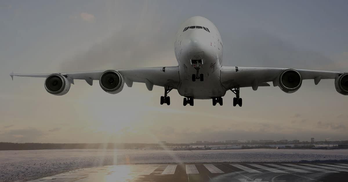 Aircraft IceGuard commercial plane landing frozen runway sunrise