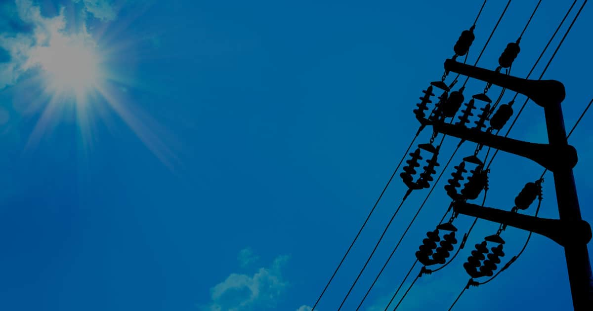 Dynamic Line Rating power line silhouette bright blue sunny sky