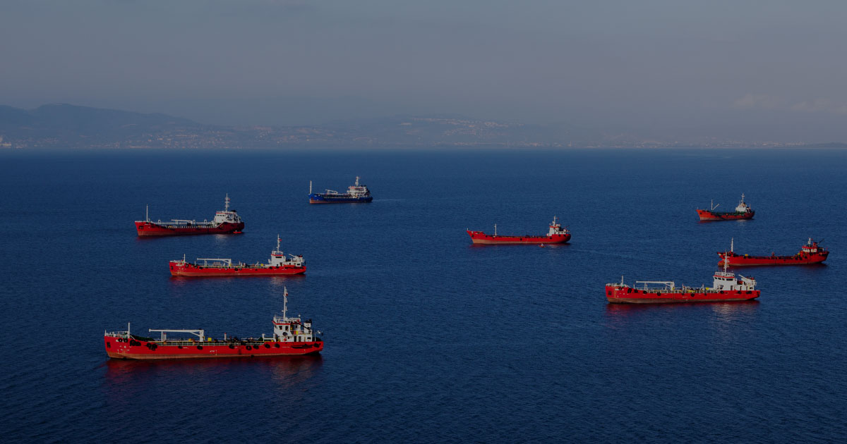 FleetGuard fleet of red cargo ship on ocean