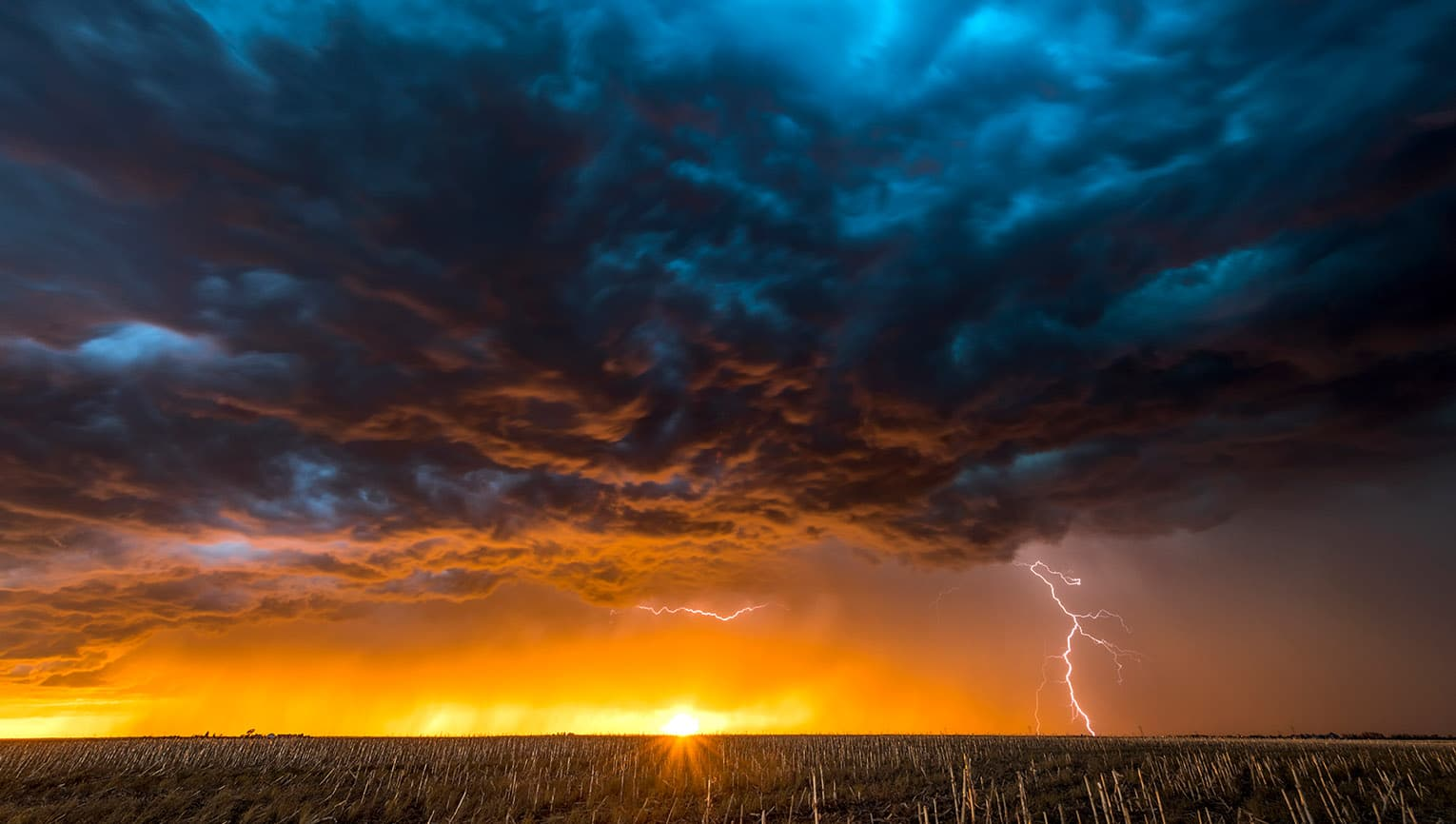 storm with lightning over field