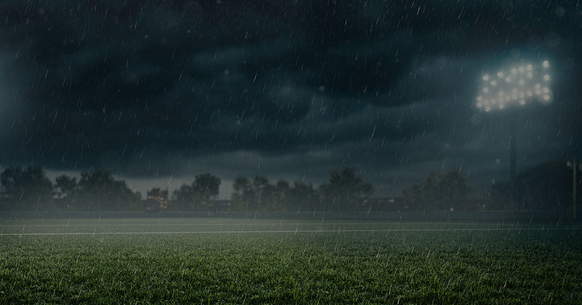 rainy field with floodlights onguard benefits bg