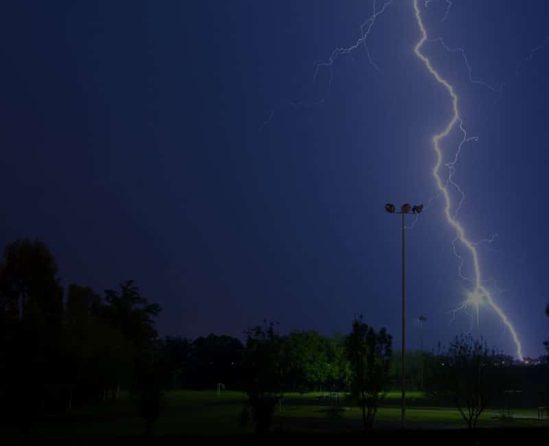 lightning over darkened sports field