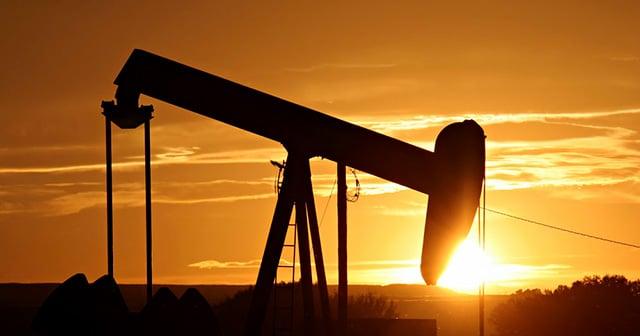 Sunrise in oil field Pumpjack Silhouette