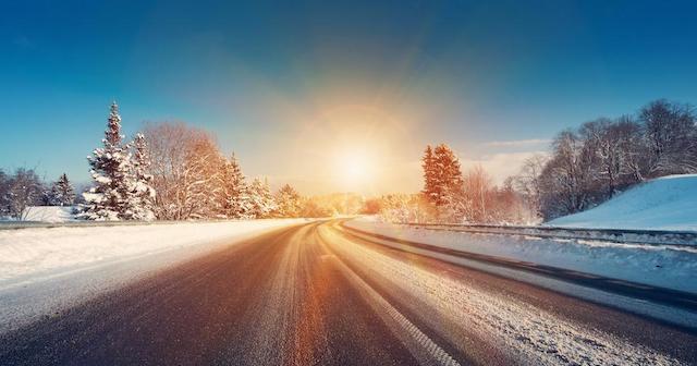 Rising sun on a winter road