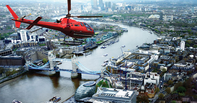 news release Helicopter Flying over Tower Bridge, London, UK