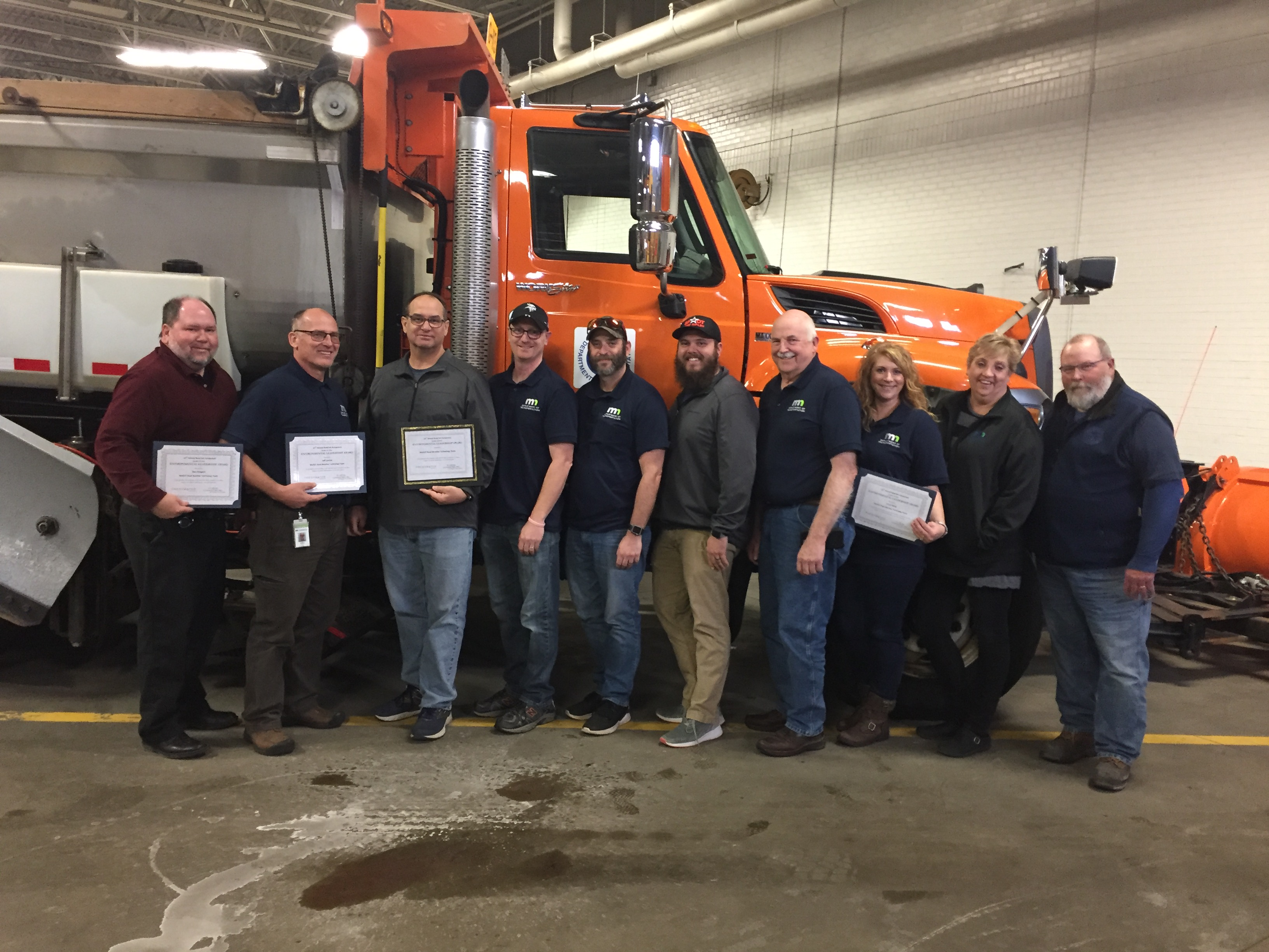 MnDOT's Road Weather Technology team poses with its Environmental Stewardship Award from the Freshwater Society