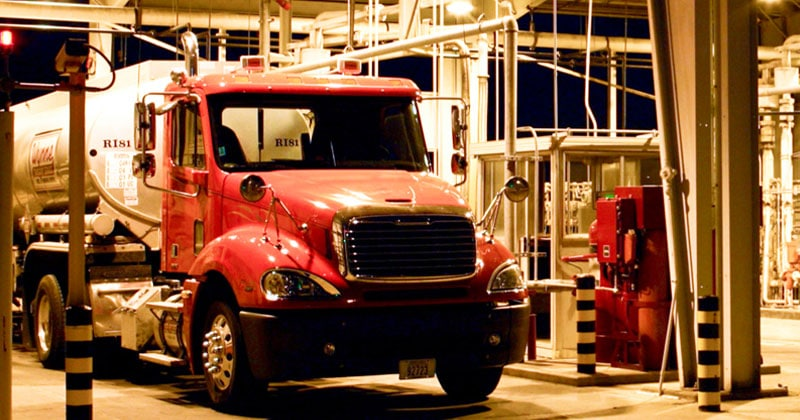red fuel truck at rack