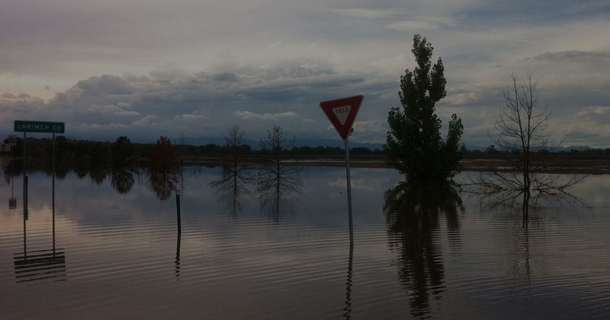 yield sign flooded road