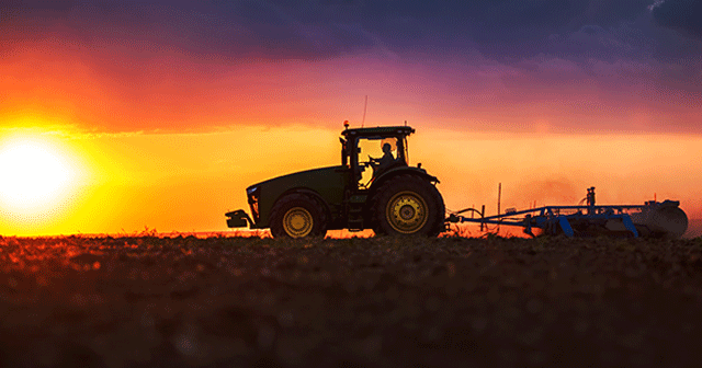 Tractor silhouette at sunrise