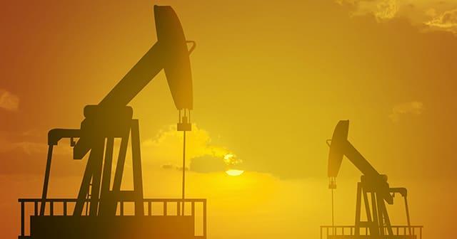Oil pumpjacks working at sunset