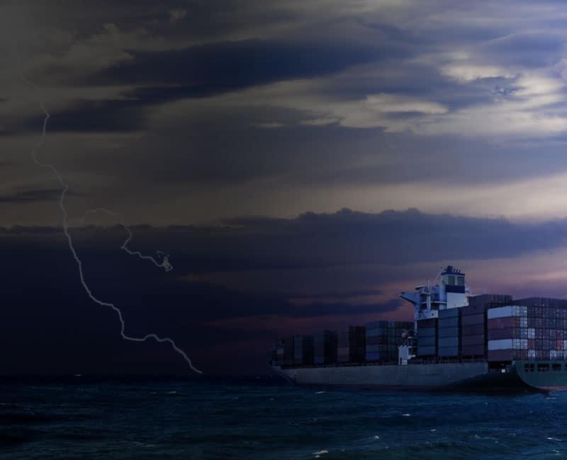 lightning near cargo ship at sea dtn marine weather api