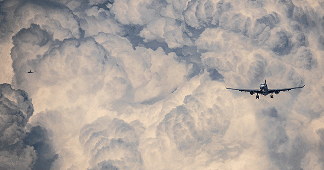 Blog Header Two Planes flying in clouded sky