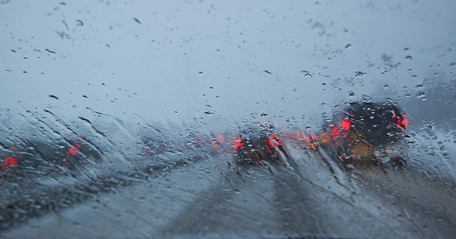 Blog header rainy car windshield