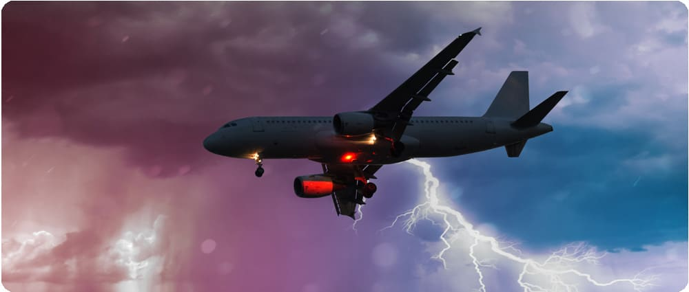Airplane flying with lightning in the background