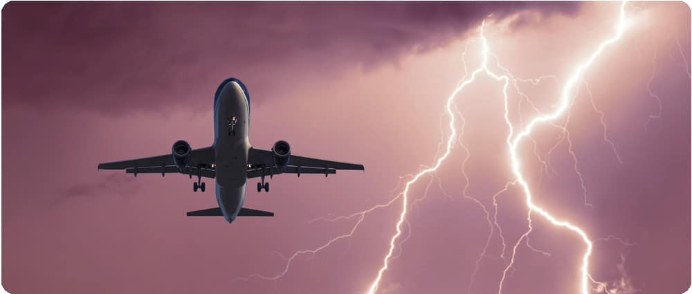 Airplane flying in the sky with lightning