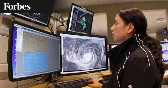 News Insights Woman monitoring weather on computer screens