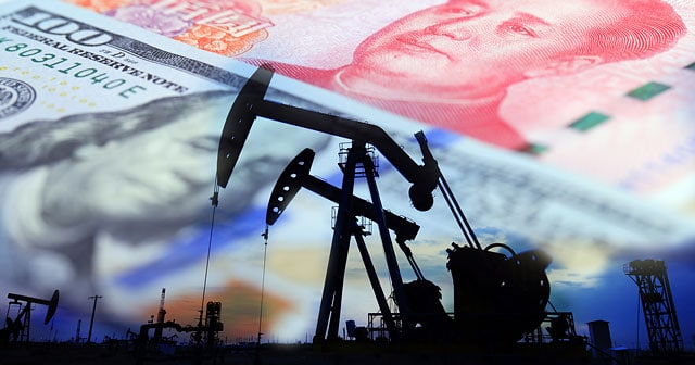 oil rig silhouette with u.s. and chinese currency background