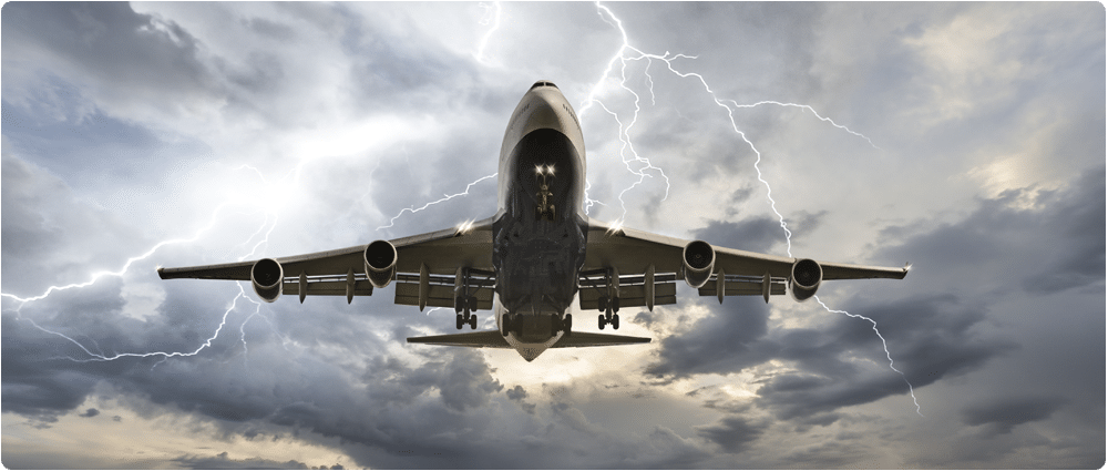Airplane flying with lighting in sky