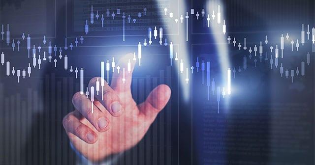 Blog Header Businessman touching graph