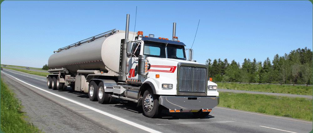 Fuel truck driving down highway