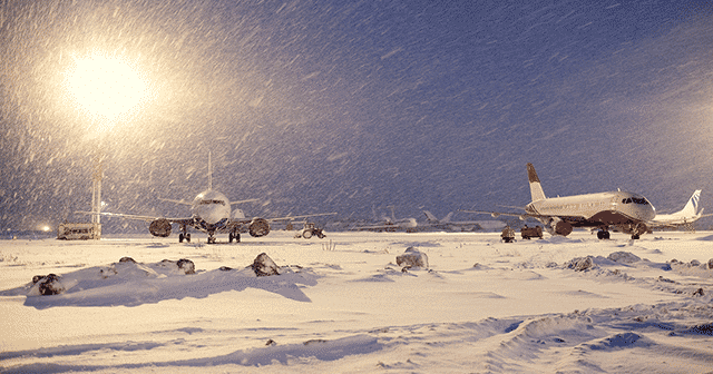 Blog Header Two grounded airplanes in the snow