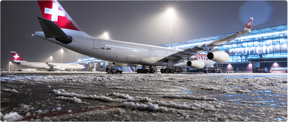 Swiss airplanes on icy tarmac