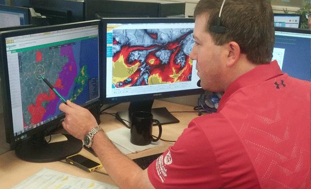 Meteorologist on Computer