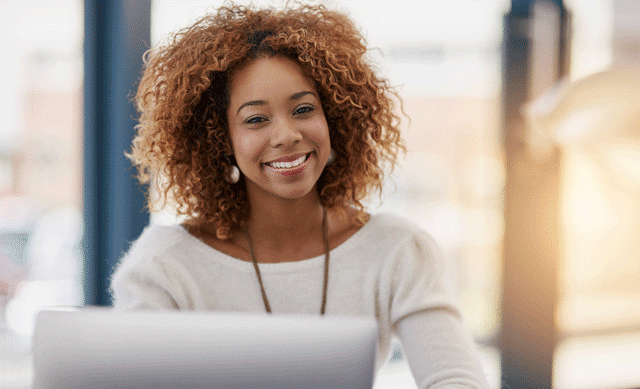 Smiling woman in front of computer