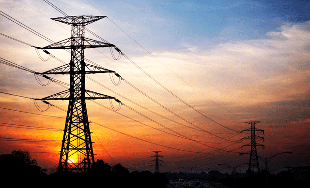 Electrical pylons in sunrise