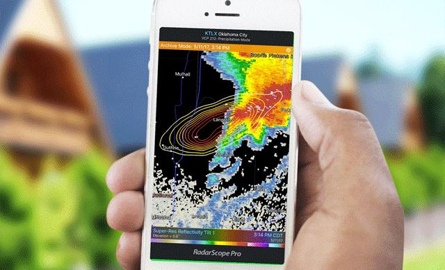 Hand holding phone with Radarscope app