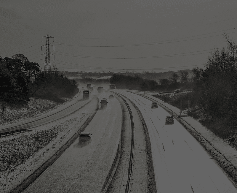 Resource Cars on Snowy Highway