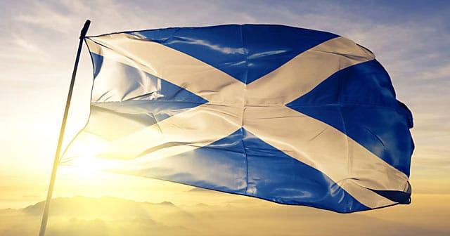 news insights scottish flag waving over sunrise