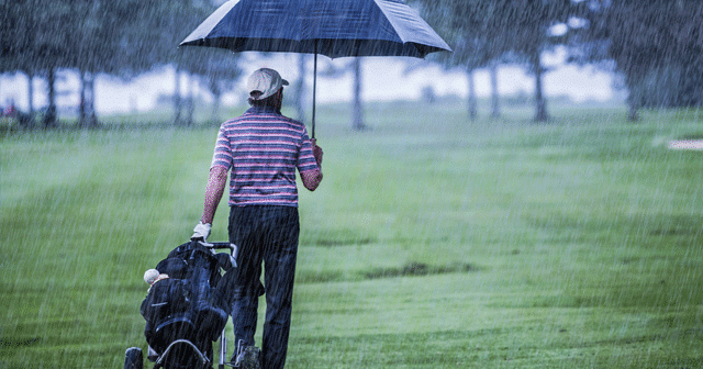 News Insights Golfer in the rain