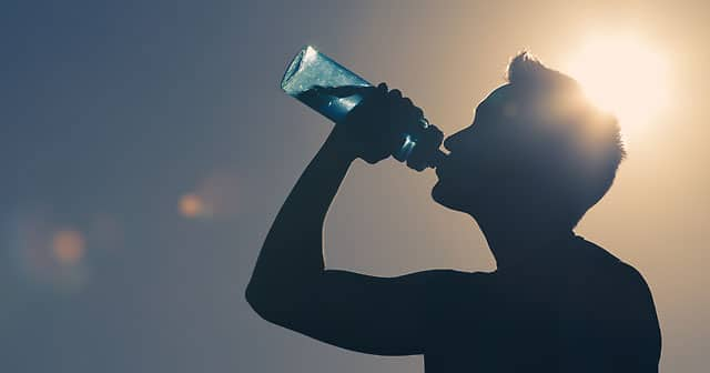 news insights athlete drinking from water bottle sunny day